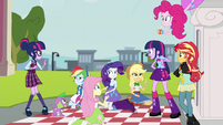 Sci-Twi waves shyly at her pony double EG3