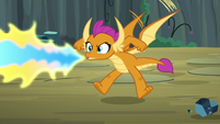 Smolder breathing fire at giant rock S9E3