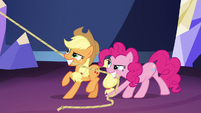 Pinkie and Applejack hoisting the chandelier S5E3