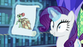Rarity levitating a drawing of a dress S6E21.png