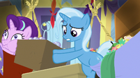 Trixie climbing out of her hammock S8E19