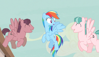 Red and pink stallions singing to Rainbow Dash S5E1