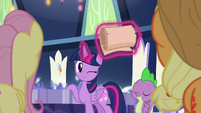 Twilight levitates a large scroll and winks S8E15