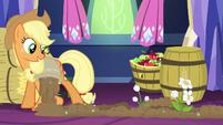 AJ pouring fertilizer in castle while flowers grow S5E03