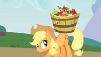 Applejack carrying a basket of apples S1E15