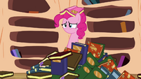 Pinkie Pie emerges from a pile of books S3E05