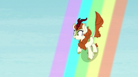 Autumn Blaze slides down a rainbow S8E23