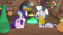 Rarity places bottle of cream in her bag S8E11
