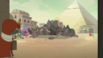 Broken Somnambula in the village square S7E18