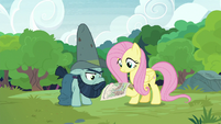 Fluttershy and Big Daddy look over the diagram S7E5