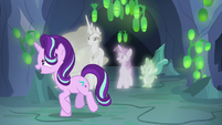 Starlight Changeling walks past Twilight, Celestia, and Spike S7E1