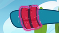 Twilight ties a weighted brace around Sky's hoof S6E24.png