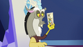 Discord holding his O&O character stand S6E17.png