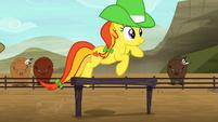 Orange rodeo mare jumping over hurdle S5E6