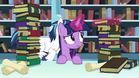 Twilight Sparkle levitates one of the books S6E2