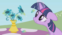 Twilight picking flower petals S1E03