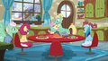 Fluttershy gives her parents a look of disbelief as Zephyr hugs her S6E11.png