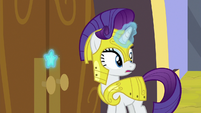 Rarity uses medal to open the castle doors S9E4
