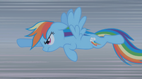 Rainbow Dash charges at the dragon S01E07
