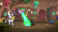 Spike belching fire under Zecora's cauldron S8E11