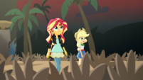 Sunset and Applejack look at the volcano movie set EGS2
