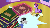 Twilight levitates the book toward her EG2