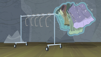 Costumes levitating off the clothes rack S8E7