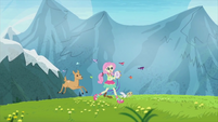 Fluttershy frolicking with animals in a field EG2