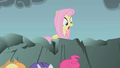Fluttershy looking at her knocked-down friends S01E07.png