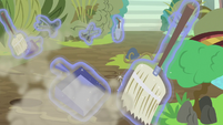 Garden tools, brooms, and dustpans float around the garden S7E25