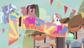 Our Town Pegasi holding festival banners S6E25.png