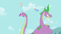 Spike swipes at Fluttershy and Rainbow Dash with tail S2E10