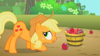 Applejack putting apples into a bucket S2E13