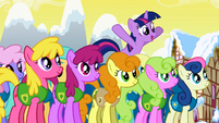Twilight jumping above the other ponies S1E11