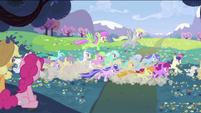 Applejack and Pinkie Pie seeing ponies chasing S2E03