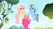 Rainbow Dash and Fluttershy about to zoom off S1E25
