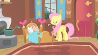 Fluttershy giving thermometer to Philomena S1E22