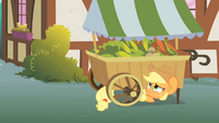 Applejack hiding under a vegetable stand S1E15