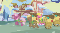 Cheerilee, Coco Crusoe, and Cherry Berry transporting nest materials S1E11