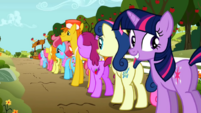 Grinning Twilight waiting in line S02E15.png