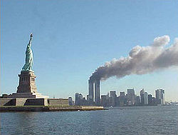 250px-National Park Service 9-11 Statue of Liberty and WTC fire