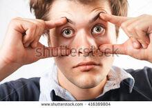 Stock-photo-eyes-open-tired-awake-young-man-416389804