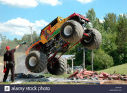 Dragon-slayer-monster-truck-jumping-over-crushed-cars-2-inwood-ontario-A0K6CK