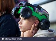 Monster-jam-trucks-fan-covering-ears-to-protect-himself-from-noise-BG301C