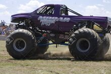 15583909-Monster-Truck-at-Car-Show-Stock-Photo-monster