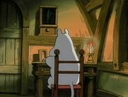 Moomintroll sitting down reading