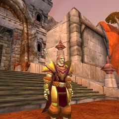 Darith upon the sands of Durotar in his Gilded Imperial Battlegear, bearing Redridge red.