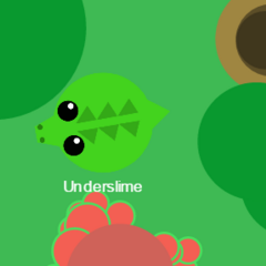 A Crocodile between a hill and a berry bush