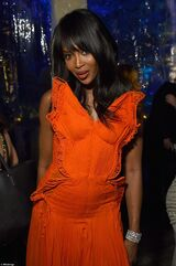 28023AC200000578-3055743-Taking flight Naomi Campbell wowed in an orange butterfly shaped-a-87 1430045787591