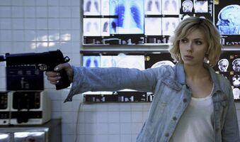 Lucy-Scarlett-Johansson-In-Action-Wallpaper